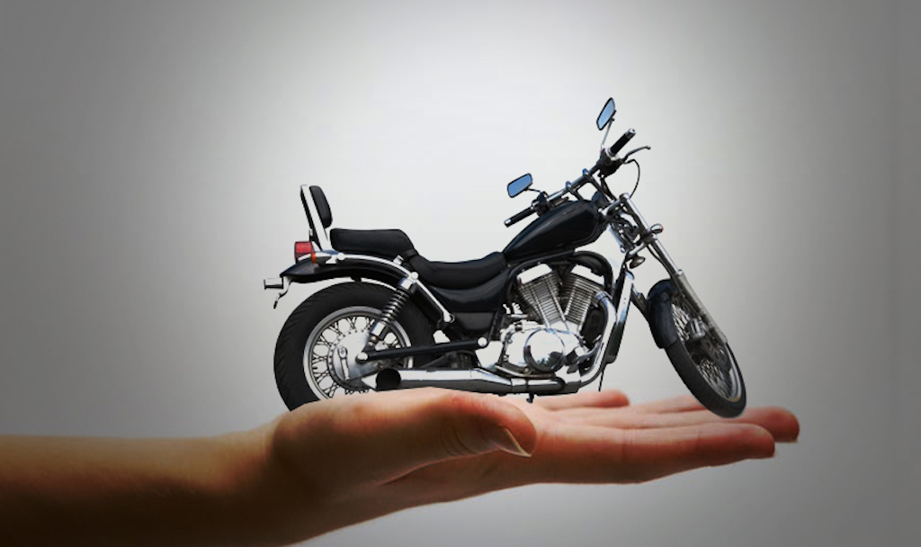 A hand with motorcycle