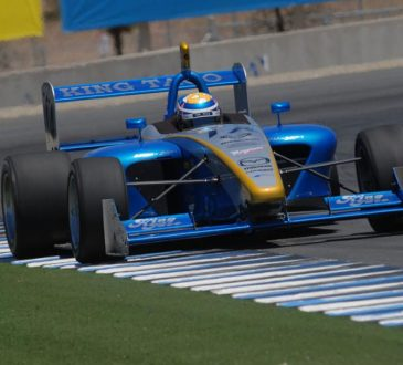 A blue car on a road