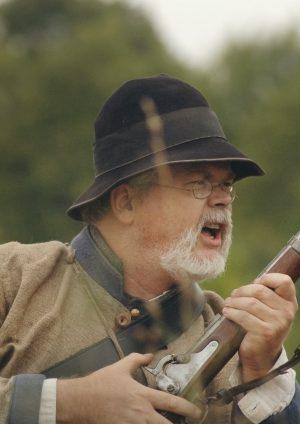 A close up of a man holding a gun