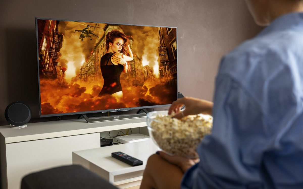 A person sitting in front of a television